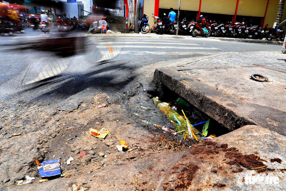 A sewer is polluted by food waste on Bach Dang Street in Binh Thanh District.