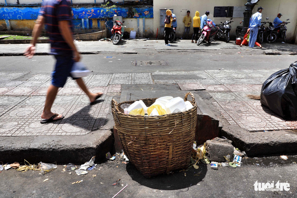 Trash blocks a drain in front of the Children's Hospital 1 in Ho Chi Minh City.