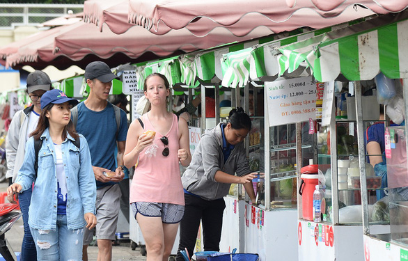 In Ho Chi Minh City, designated areas for street food sellers start to bear fruit