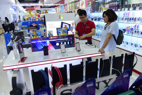 Vietnam's Vingroup divests retail business to focus on cars, smartphones