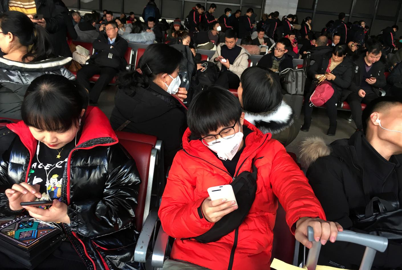 As virus spreads to more Chinese cities, WHO calls emergency meeting