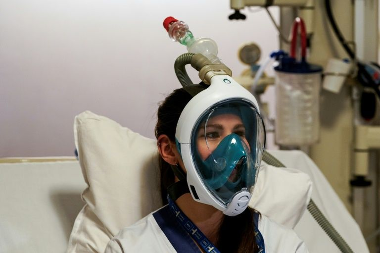 Hospitals turn to snorkel masks to ease respirator overload
