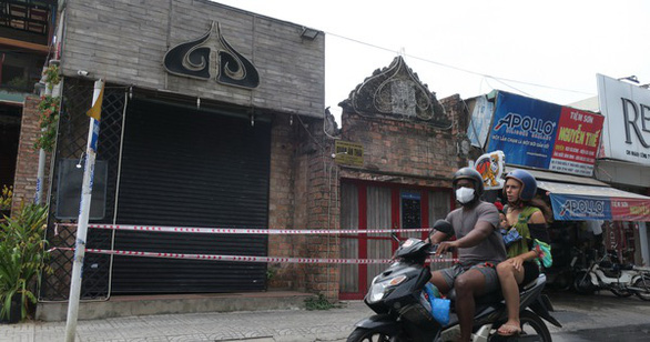 Two foreigners ride a motorbike past the sealed-off Buddha bar in District 2, Ho Chi Minh City in this undated file photo. Photo: T.T.D. / Tuoi Tre