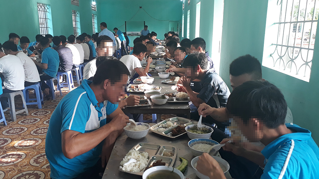 Collaborators and rehab residents enjoy lunch in a shared space at Gia Minh Rehab Center in Hai Phong City, Vietnam. Photo: Tam Le / Tuoi Tre