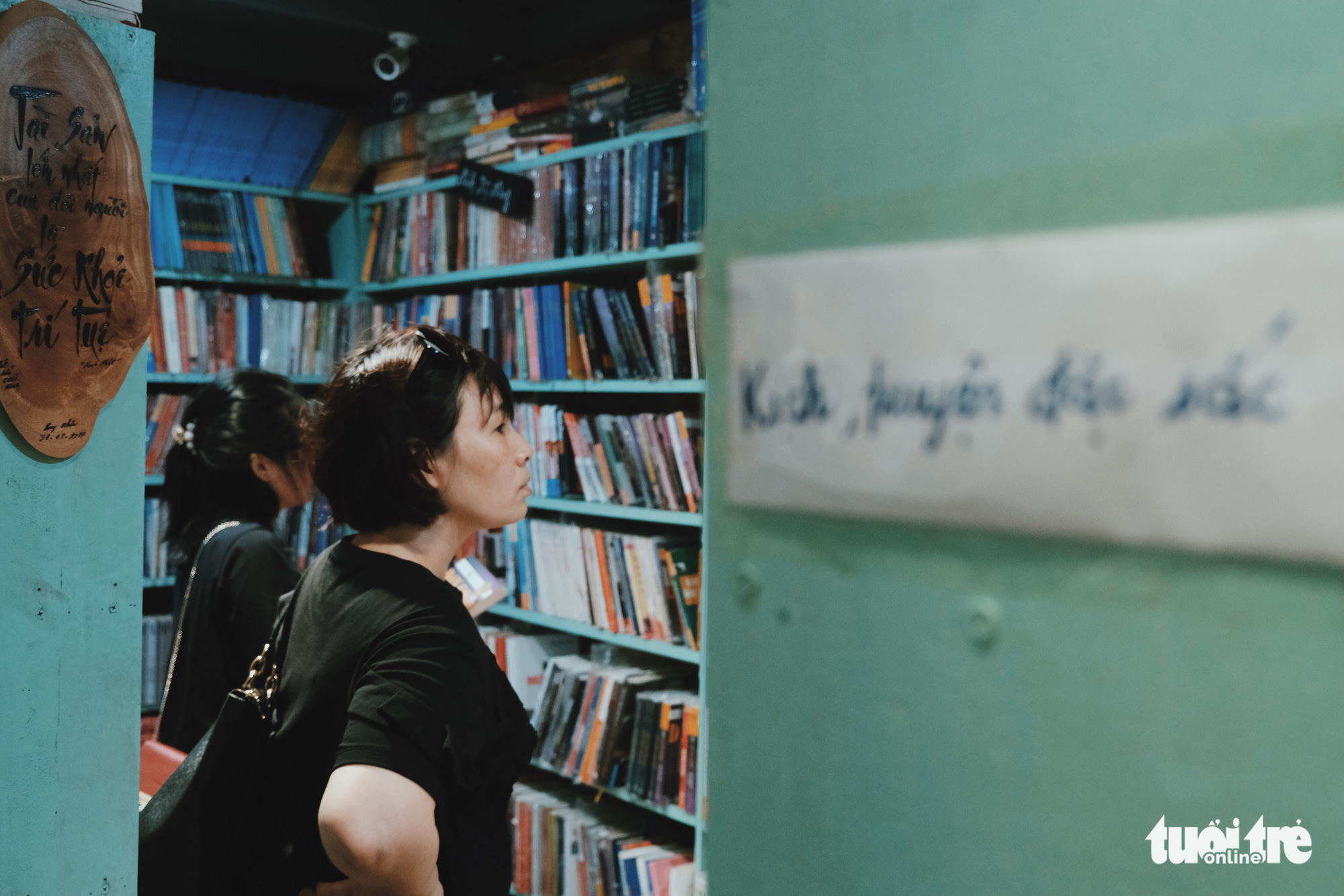 Two women look at bookshelves in a bookstore at No. 5 Dinh Le Street, Hanoi, Vietnam. Photo: Song La / Tuoi Tre