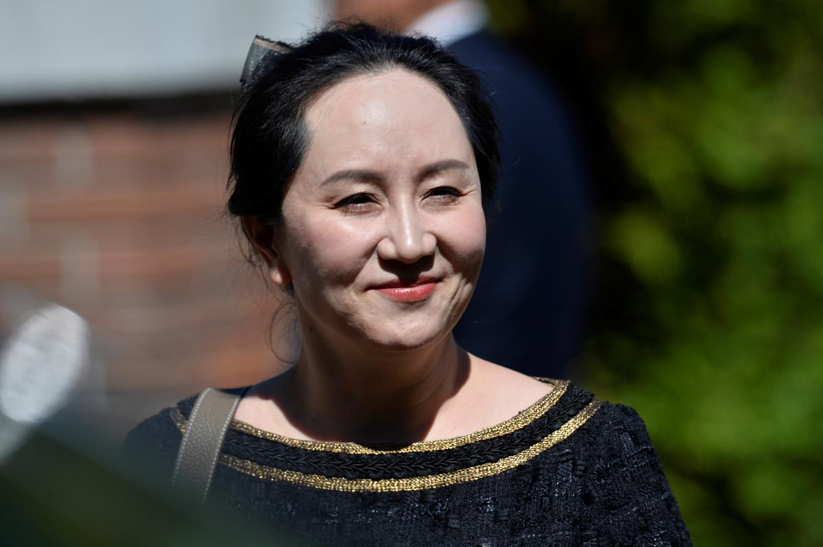 Huawei Technologies Chief Financial Officer Meng Wanzhou smiles as she leaves her home to attend a court hearing in Vancouver, British Columbia, Canada May 27, 2020. Photo: Reuters