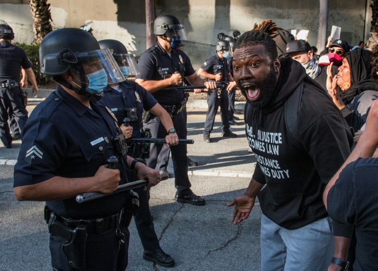A demonstrator confronts police in Los Angeles as he protests the death of George Floyd in police custody in Minneapolis. Photo: AFP