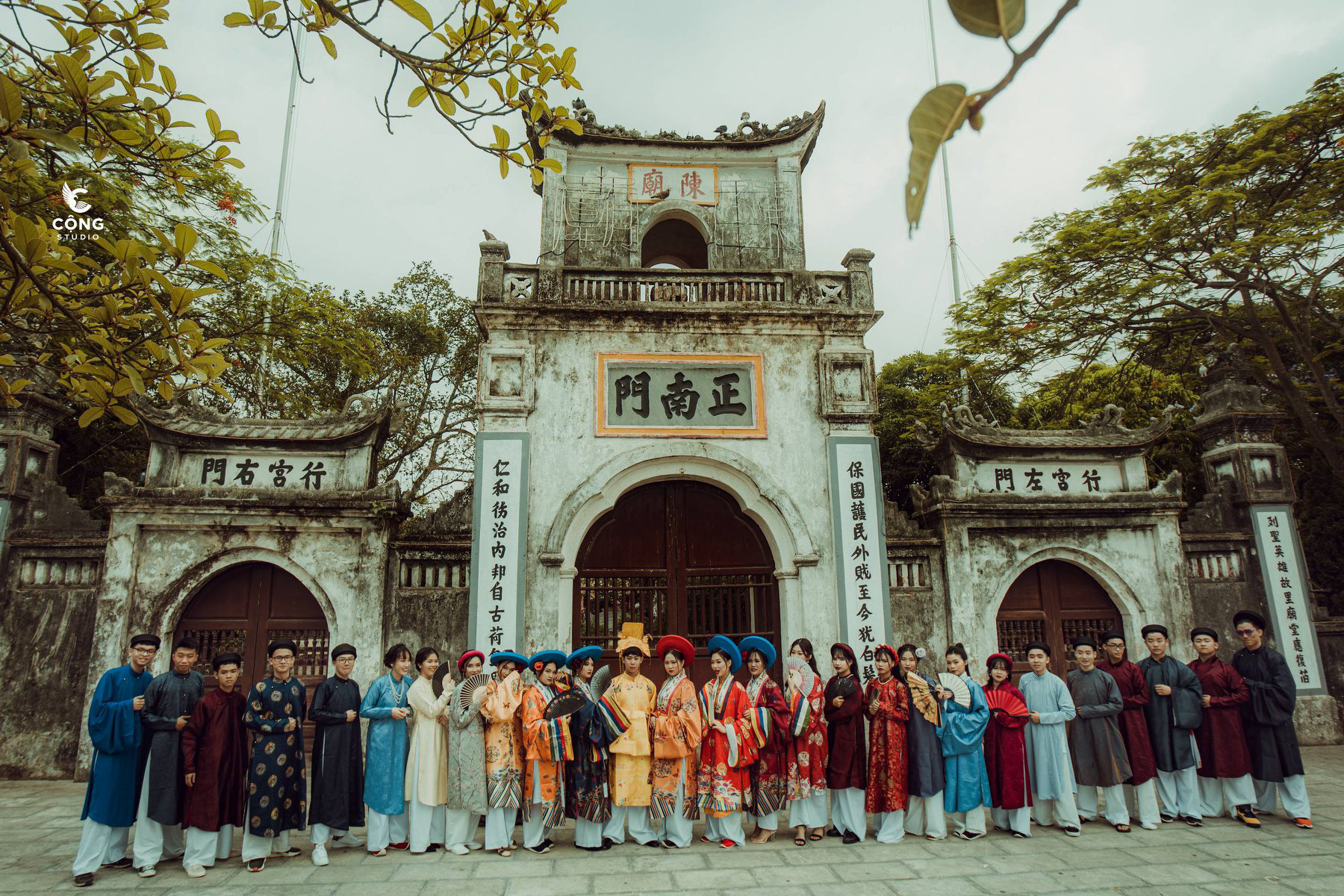 12th-grade French majors at the Le Hong Phong High School for the Gifted in Nam Dinh Province, Vietnam pose for a 'royal family photo' at the Tran Temple wearing ancient costumes in this supplied yearbook photo.