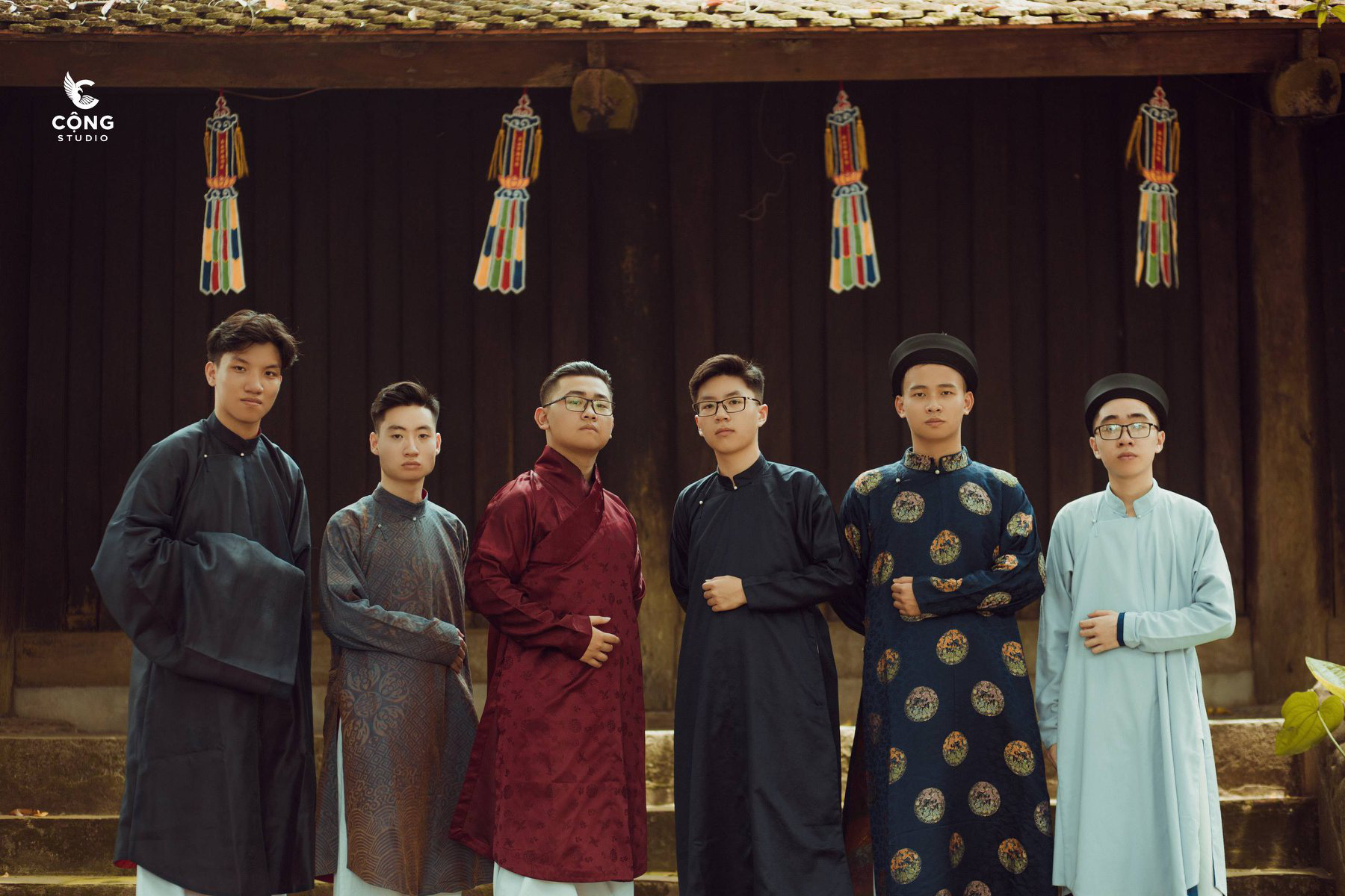 Six male students wear Vietnamese ancient costumes in this supplied yearbook photo.