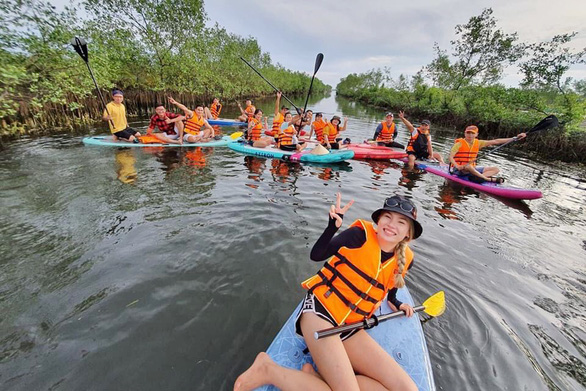 Visitors play paddling at Tam Giang Lagoon, Thua Thien-Hue Province, Vietnam in this undated file photo. Photo: Minh Thanh / Tuoi Tre
