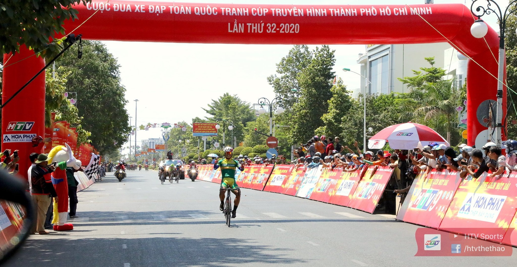 A cyclist celebrates as he crossed the finish line in Ninh Thuan Province, located in south-central Vietnam, in the 14th stage of the annual HTV Cup organized by Ho Chi Minh City Television, June 3, 2020. Photo: HTV