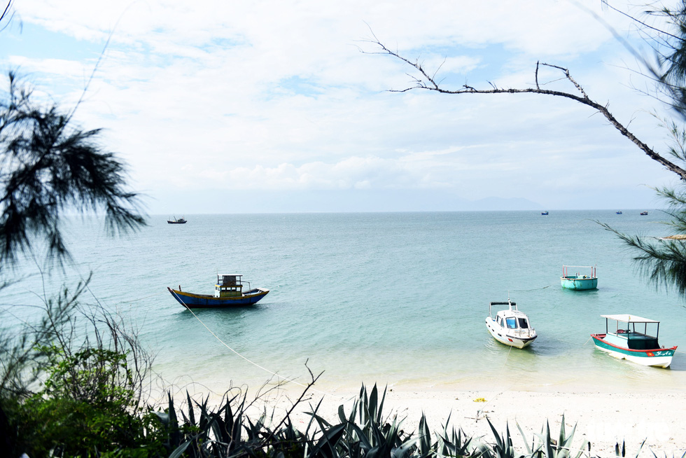 Boats are docked by a beach on Cu Lao Cau off Tuy Phong District, Binh Thuan Province, Vietnam. Photo: Duyen Phan / Tuoi Tre
