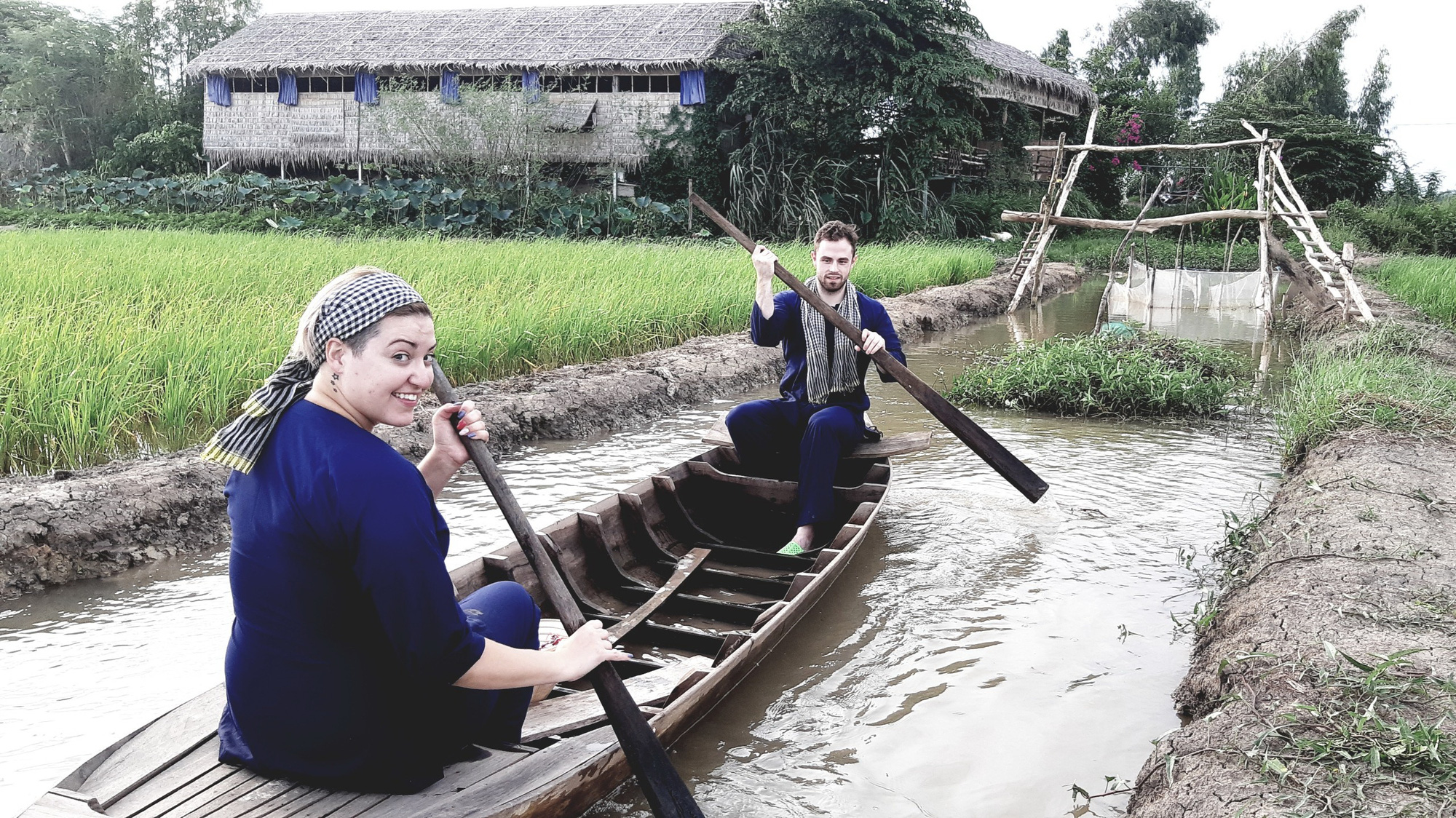 Two foreign tourists indulge themselves in rustic delights at Viet Mekong Farmstay, nestled in Tam Nong District, Dong Thap Province in Vietnam's Mekong Delta, in this provided photo.