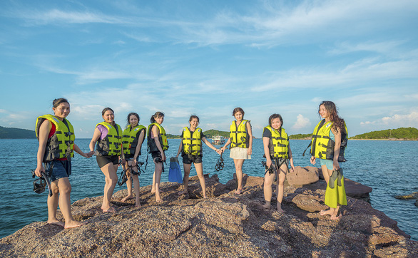 Tourists pose for photos on Hom May Island, part of Phu Quoc Island off the southern province of Kien Giang, Vietnam. Photo: Quang Dinh / Tuoi Tre