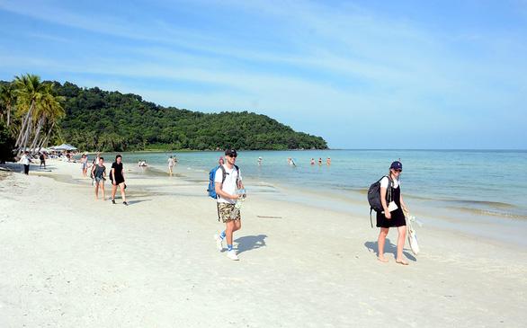 Tourists walk along Bai Khem, one of the most beautiful beaches on Phu Quoc Island off Kien Giang Province, Vietnam. Photo: K.Nam / Tuoi Tre