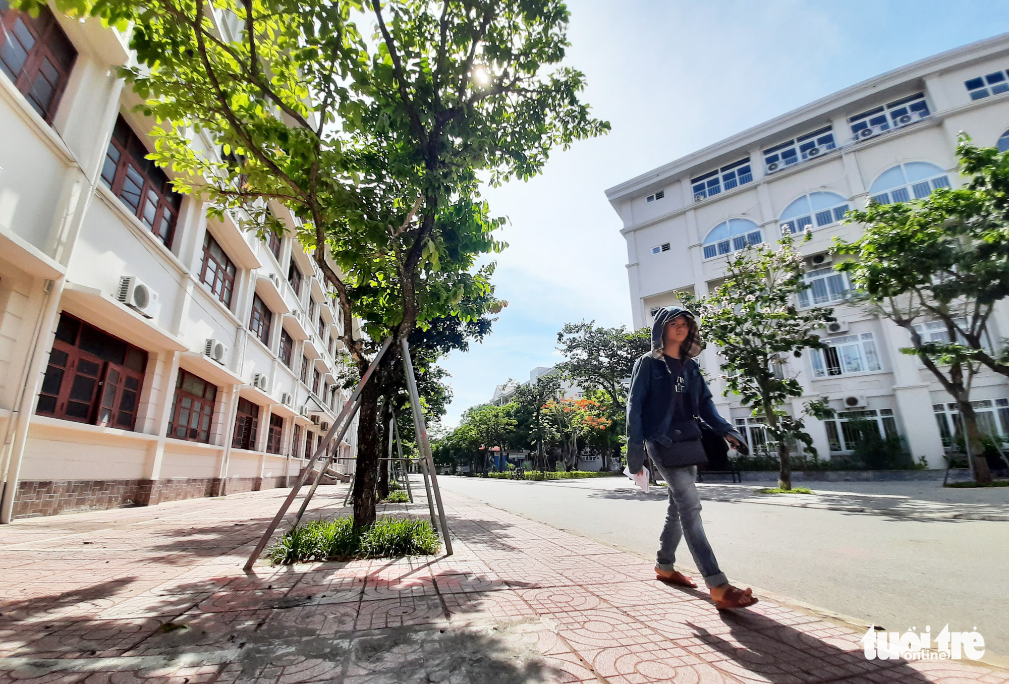 A student walks on the premises of Vinh University in Nghe An Province, Vietnam. Photo: Doan Hoa / Tuoi Tre