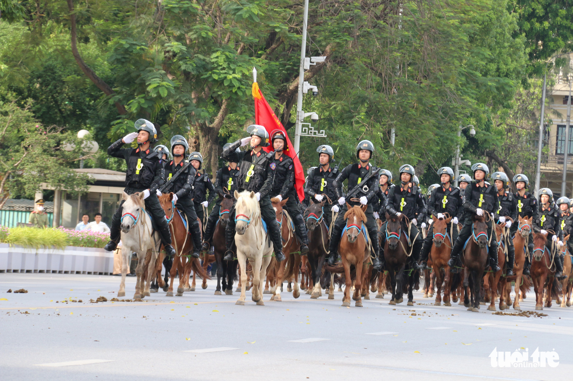 Officers from the Mounted Mobile Police Corps march during a ceremony at Ba Dinh Square in Hanoi, Vietnam, June 8, 2020. Photo: Tien Long / Tuoi Tre