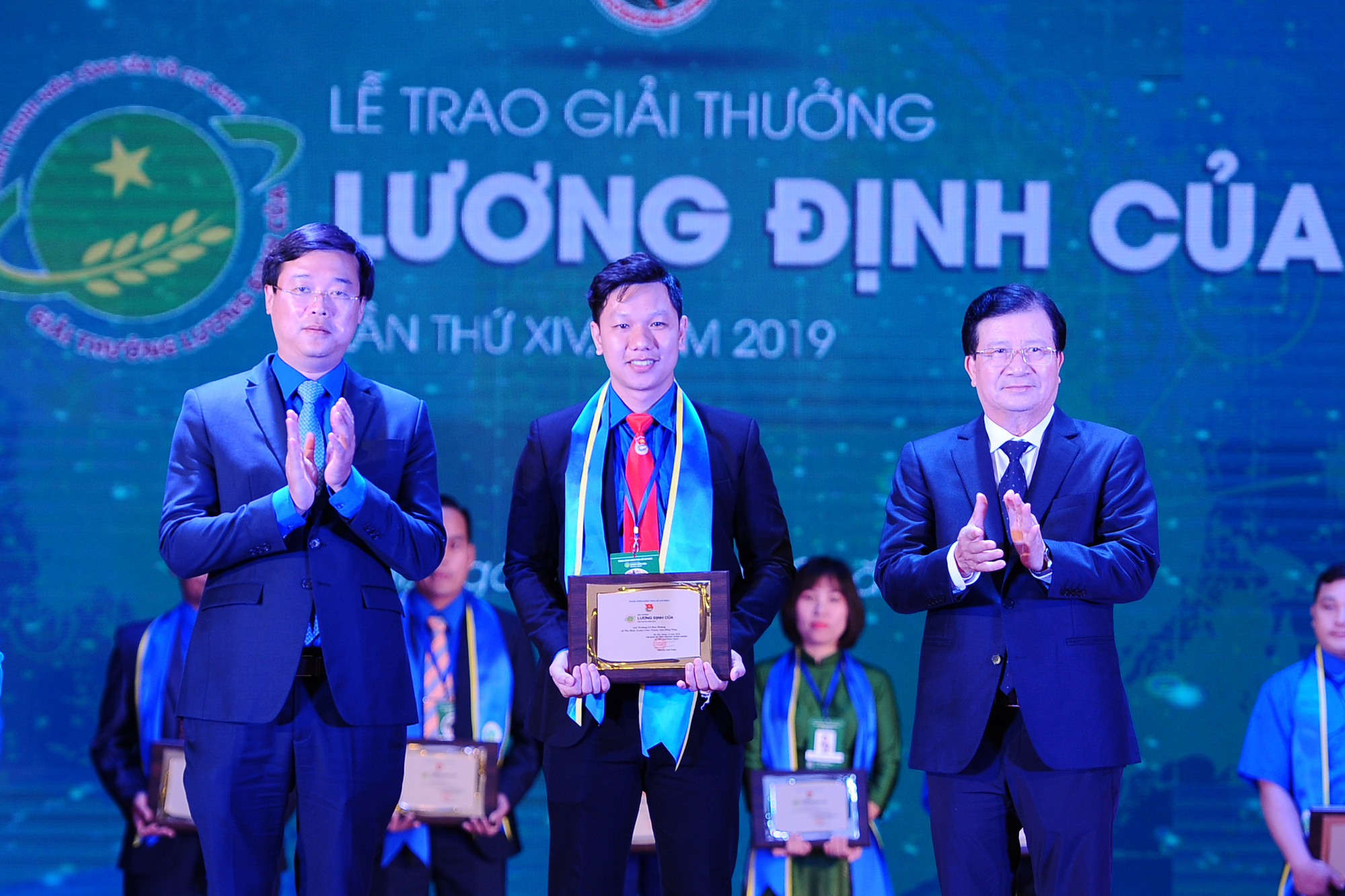 Truong Le Huy Hoang receives the 2019 Luong Dinh Cua awards for agricultural entrepreneurs who benefit the community in this supplied photo.