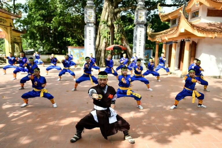 Master Nguyen Khac Phan (front) leads students through a training class in centuries-old martial art Thien Mon Dao inside the Bach Linh temple compound at Du Xa Thuong village in Hanoi. Photo: AFP