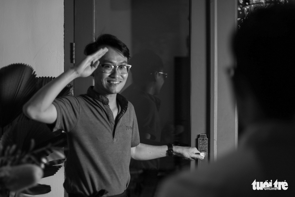 A staff at Noir greets customers to his place. Photo: Ngoc Phuong/ Tuoi Tre