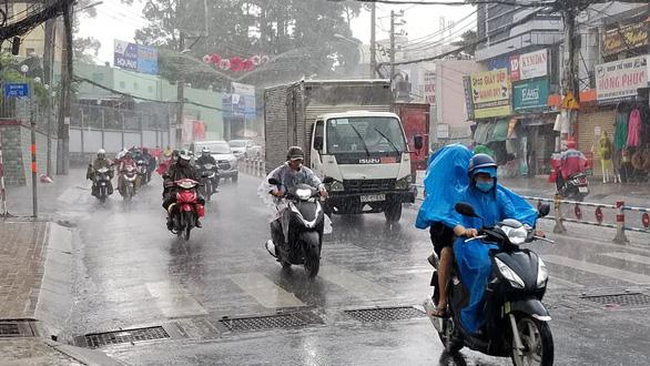 People ride motorbikes in a rain on Vo Van Ngan Street in Thu Duc District, Ho Chi Minh City, Vietnam, June 13, 2020. Photo: Chau Tuan / Tuoi Tre
