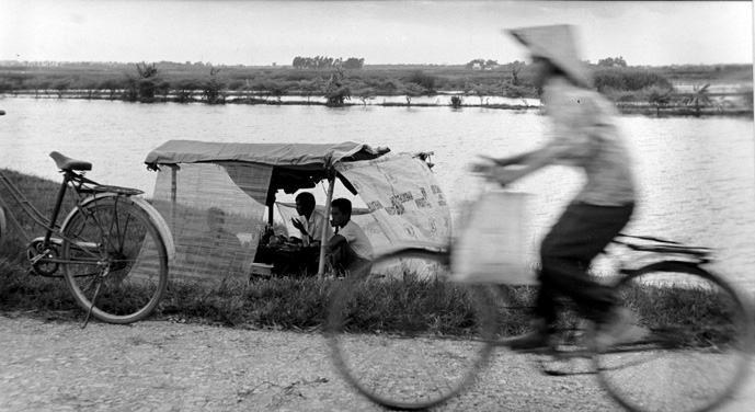 A woman rides a bicycle past a ferry boat in rural Vietnam in this supplied photo. Photo: Nguyen Huu Tuan