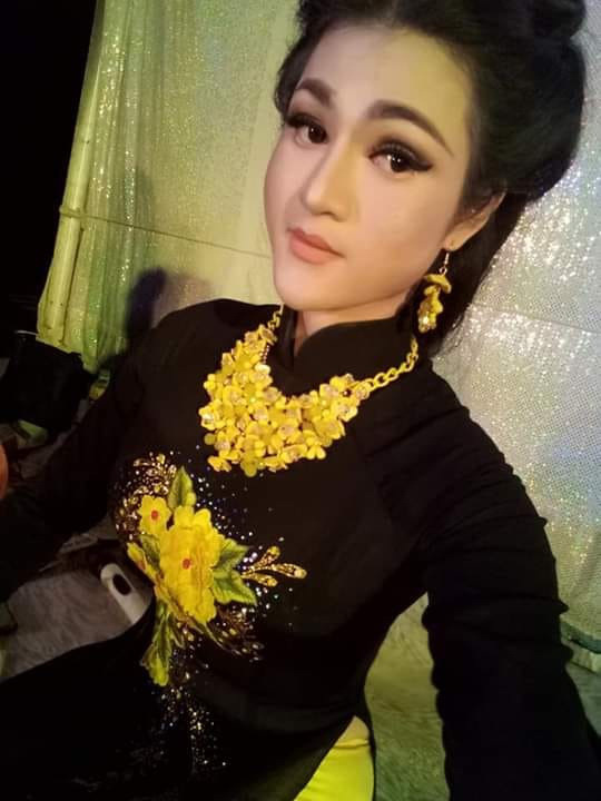 Du Kha Ai, a transgender funfair singer in Khanh Hoa Province, Vietnam, is seen in a traditional Vietnamese costume in this supplied photo.