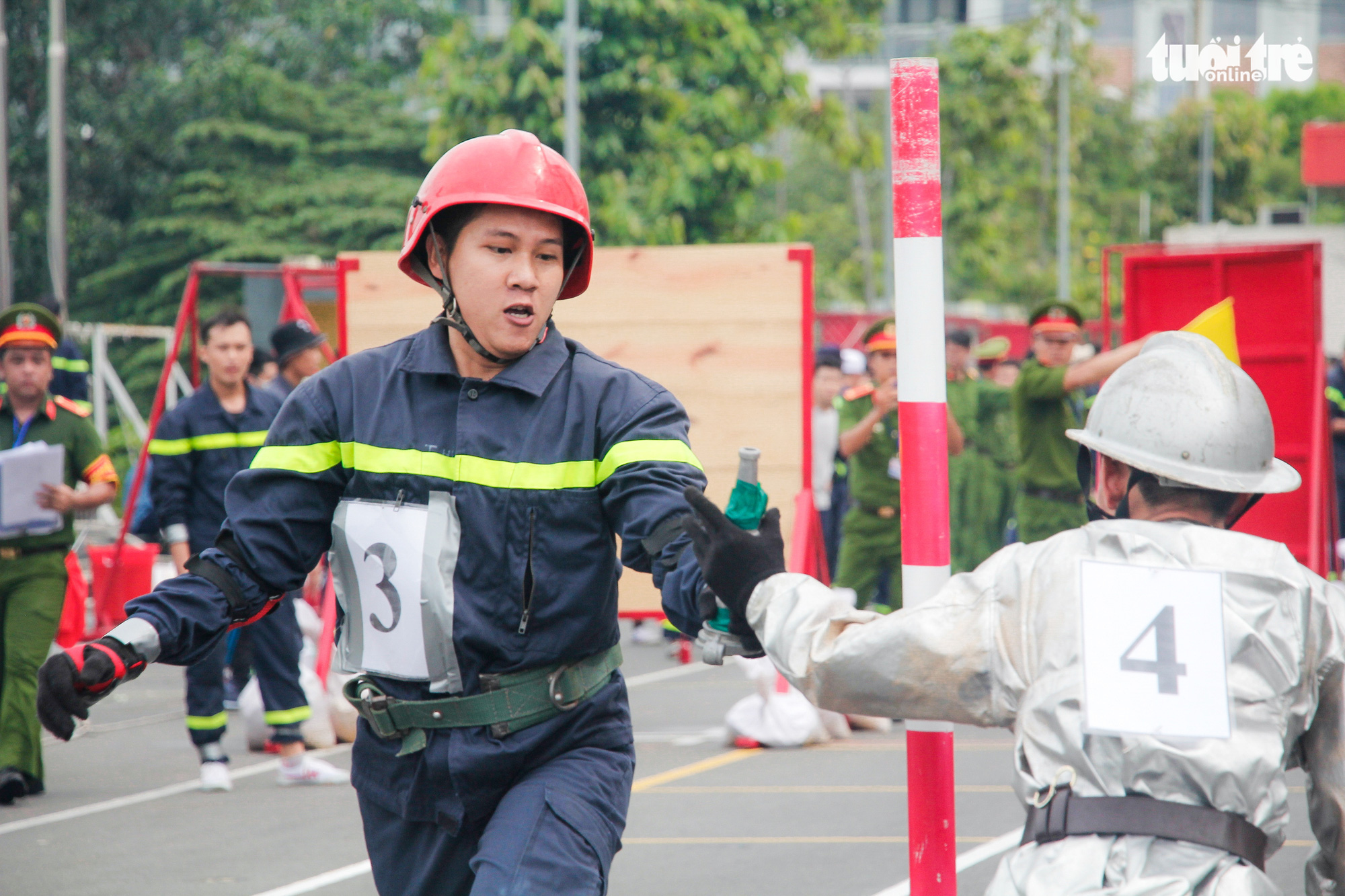 Firefighters participate in a relay race during a firefighting and rescue competition in Ho Chi Minh City, June 16, 2020. Photo: Chau Tuan / Tuoi Tre