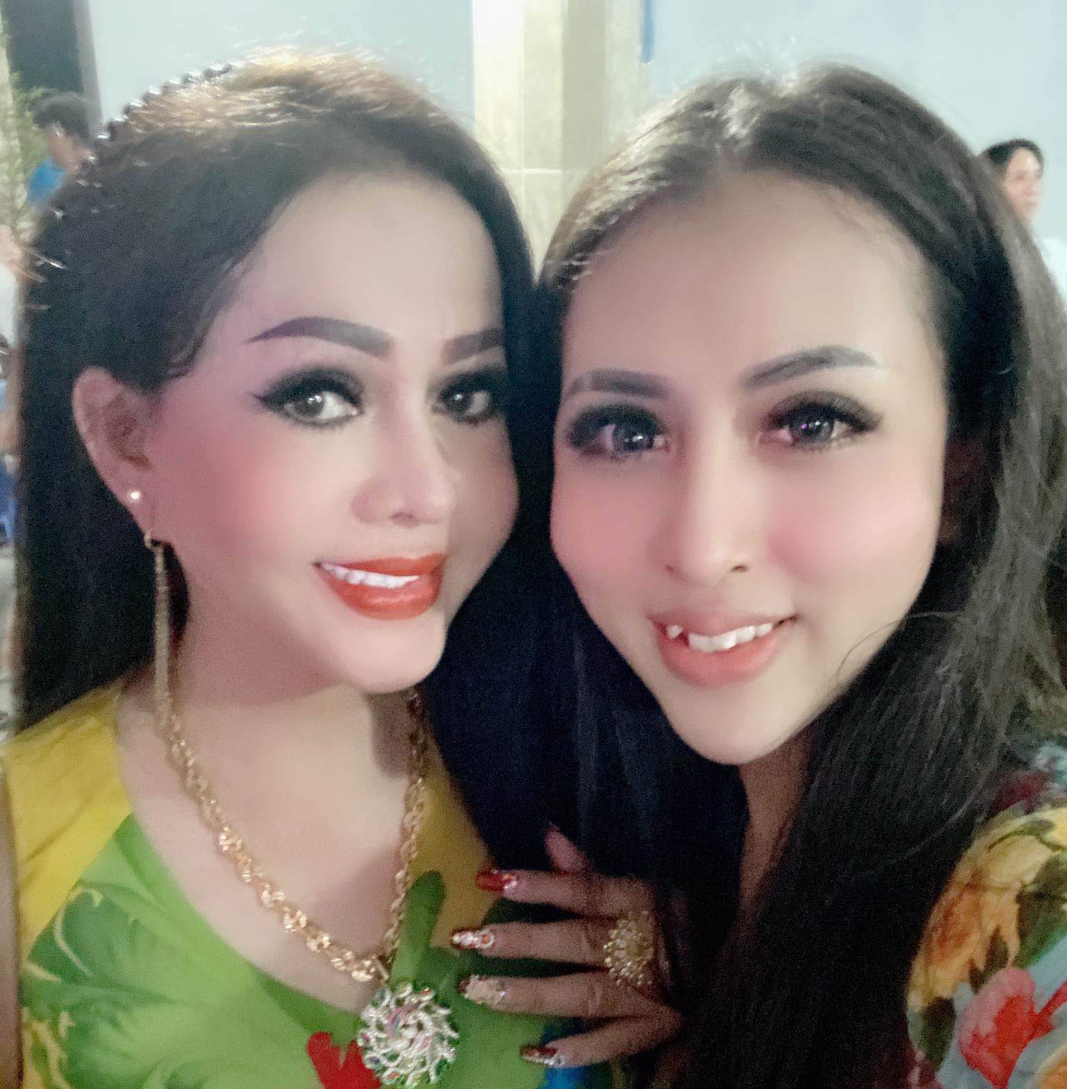 Khanh Du (right), a transgender singer working in Long An Province, Vietnam, is seen with another transgender colleague in this supplied photo.