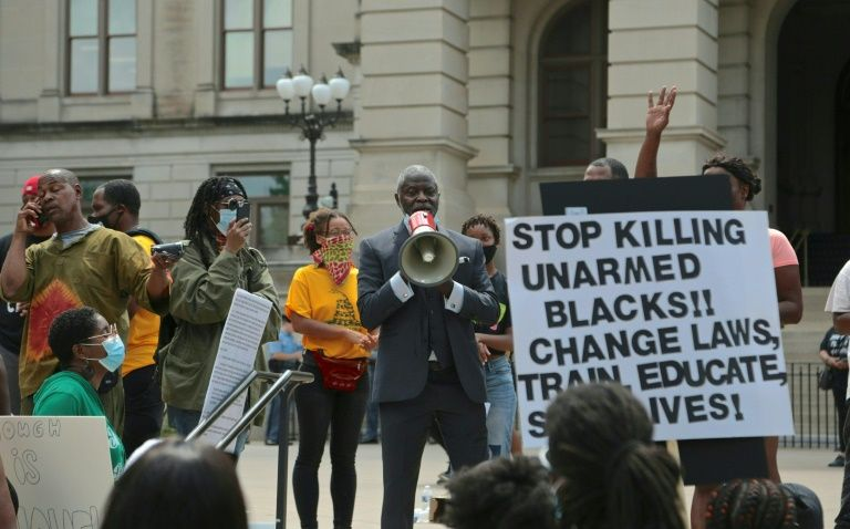 Protestors in Atlanta demonstrate on June 15 against the police shooting of 27-year-old Rayshard Brooks, during a confrontation after Brooks was found asleep in his car at a fast food restaurant. Photo: AFP