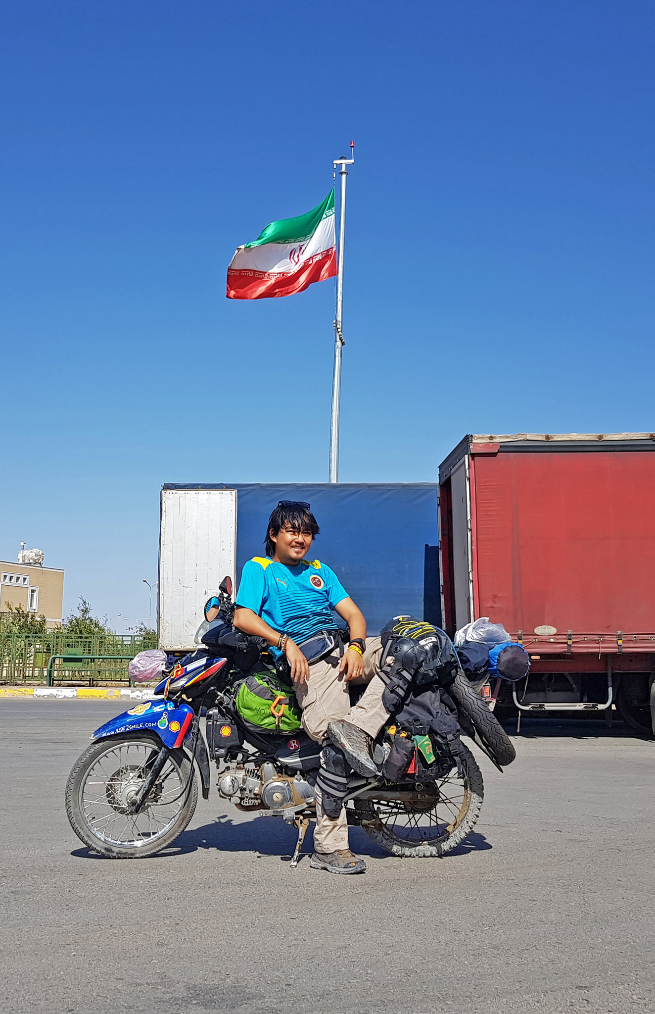 Vietnamese globetrotter Tran Dang Dang Khoa poses for a photo with his motorbike in Iran in a photo posted to his verified Facebook account.