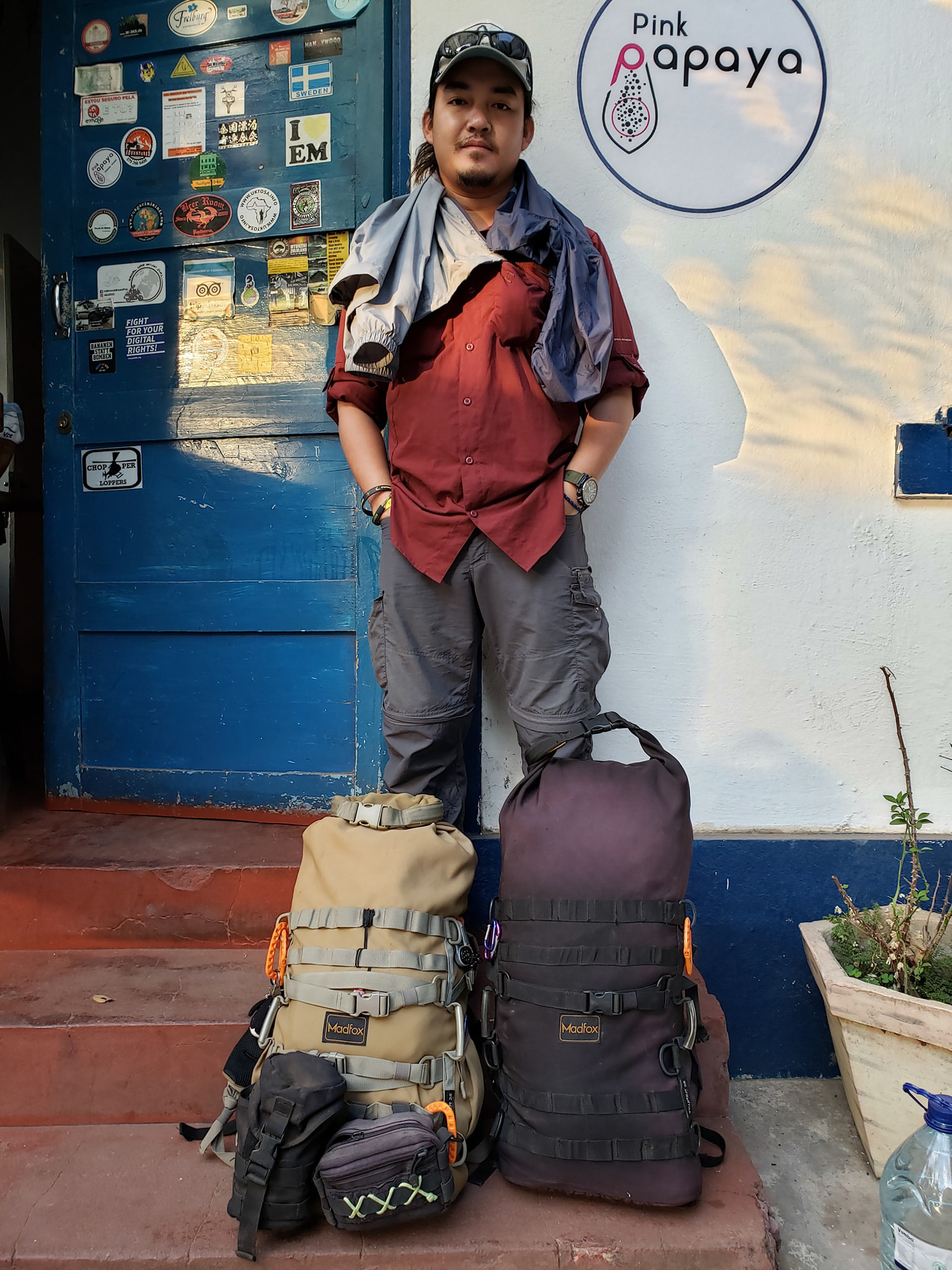 Vietnamese globetrotter Tran Dang Dang Khoa stands beside his two big backpacks before a flight back to Vietnam after over 1,000 days traveling the world, June 15, 2020 in this photo posted to his verified Facebook account.