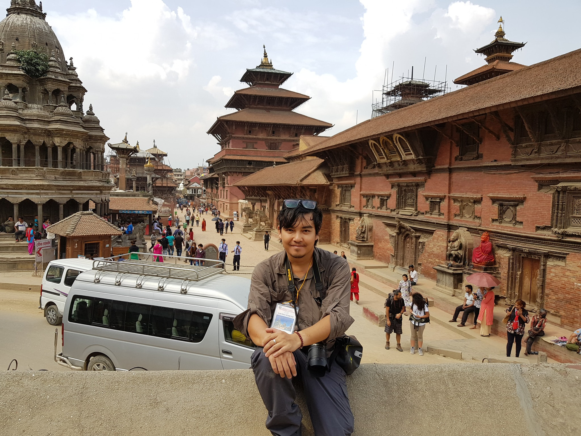 Vietnamese globetrotter Tran Dang Dang Khoa poses for a photo against the backdrop of pagodas at a tourist attraction in Kathmandu, Nepal in a photo posted to his verified Facebook account.