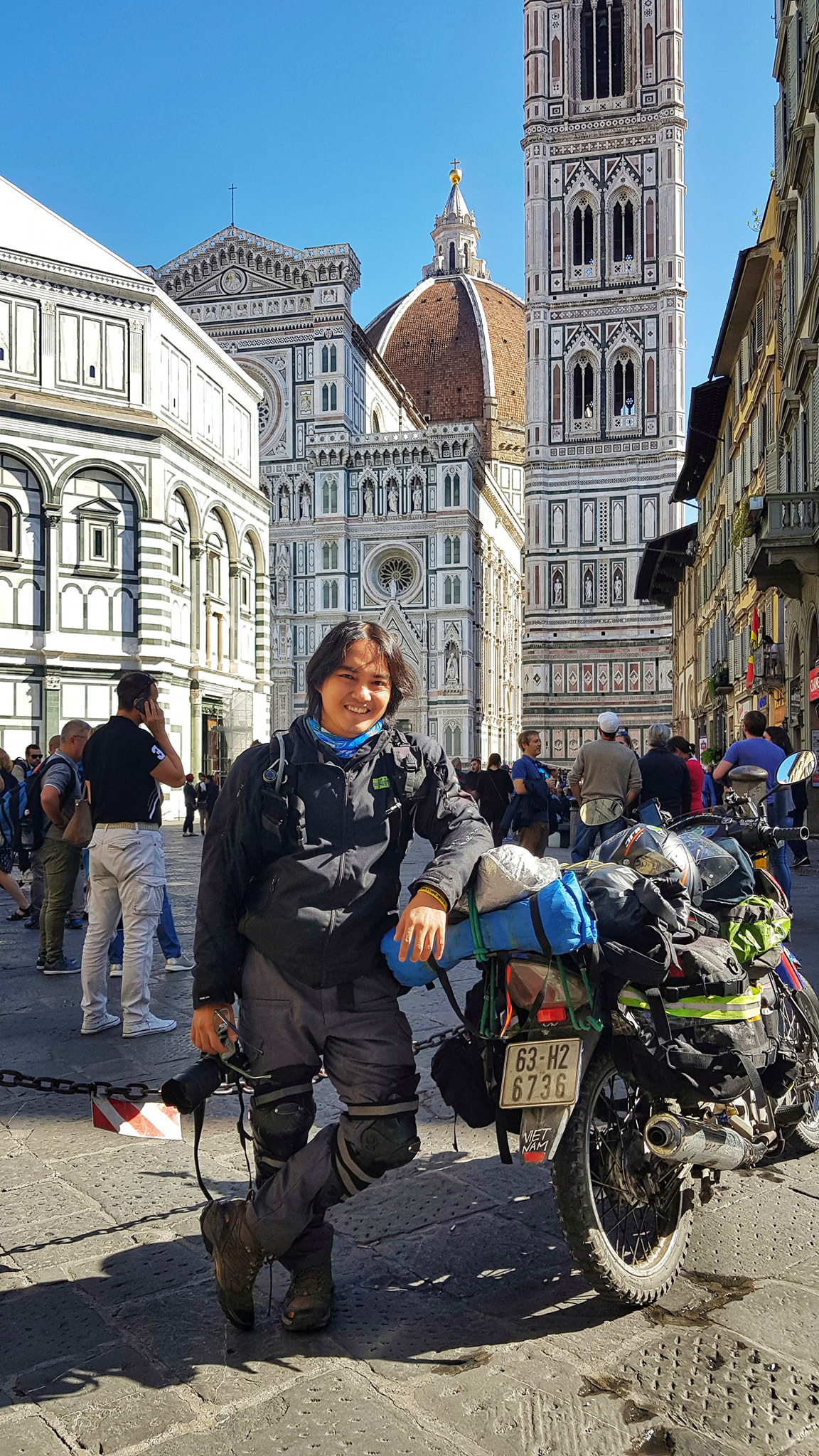 Vietnamese globetrotter Tran Dang Dang Khoa poses for a photo with his motorbike in Italy in a photo posted to his verified Facebook account.