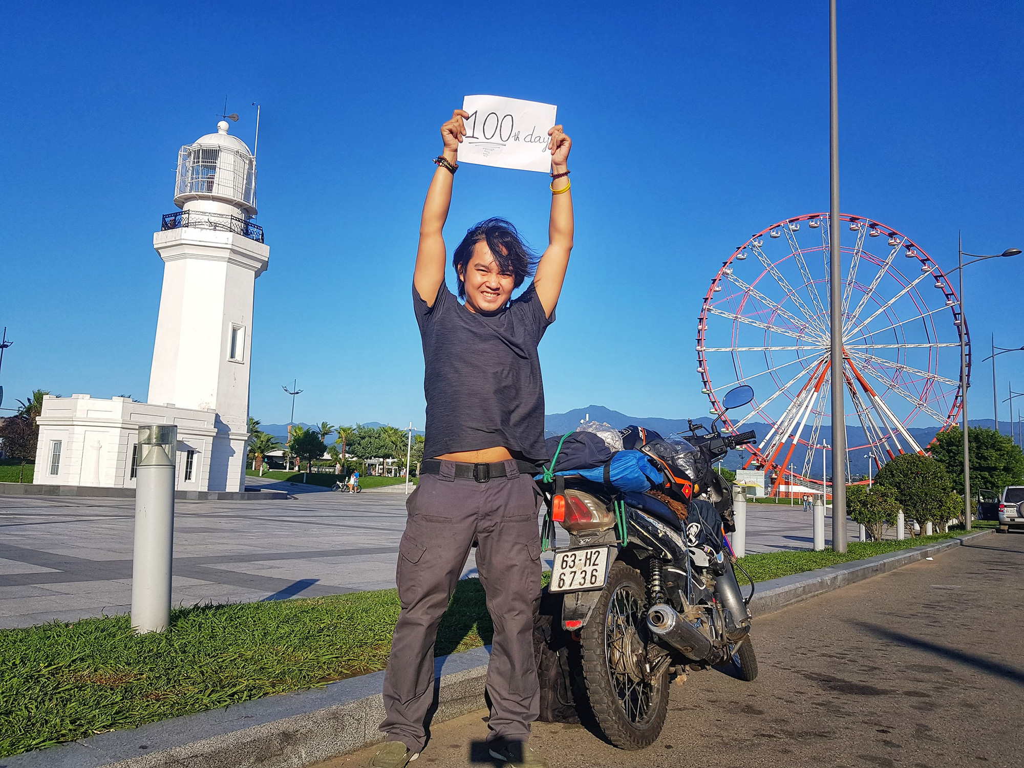 Vietnamese globetrotter Tran Dang Dang Khoa poses for a photo with his motorbike in Batumi, Georgia on the 100th day of his journey around the world in a photo posted to his verified Facebook account.