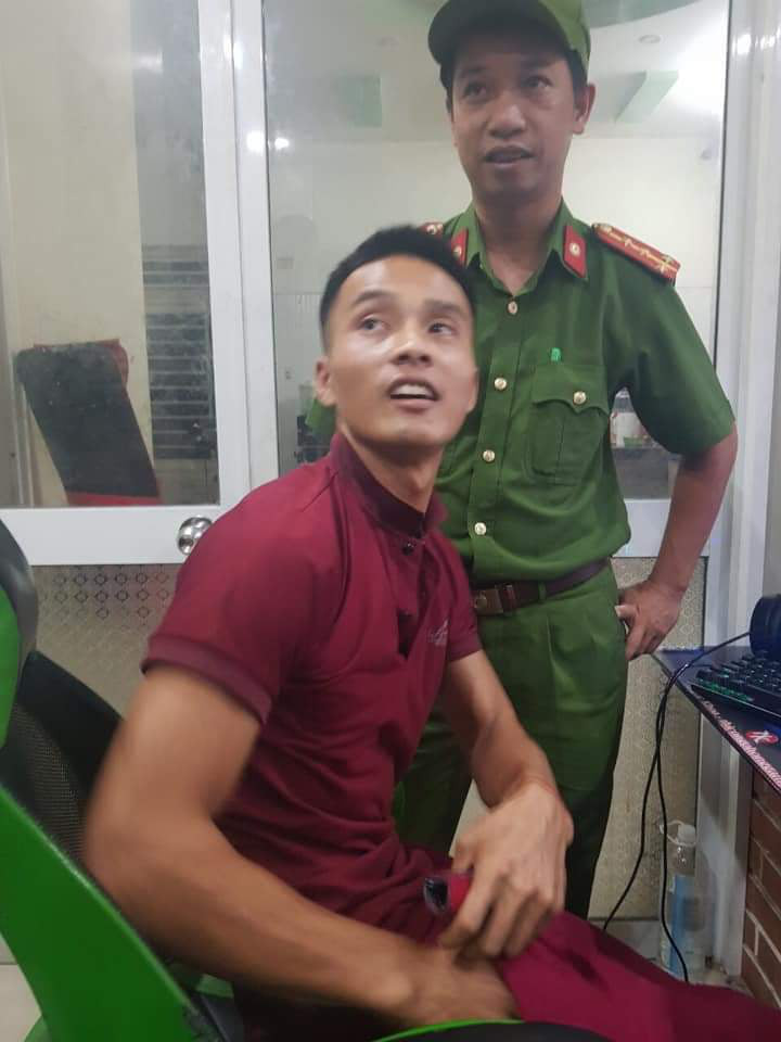 Trieu Quan Su is arrested at an online game center in Tam Ky City, Quang Nam Province, Vietnam, June 18, 2020 in this photo supplied by officers.
