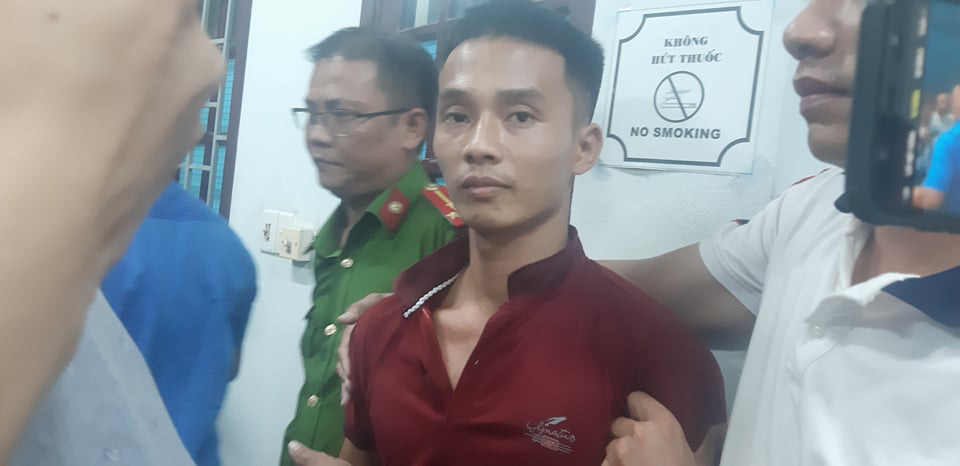 Trieu Quan Su (in red T-shirt) is held at the police station in Tam Ky City, Quang Nam Province, Vietnam, June 18, 2020. Photo: Le Trung / Tuoi Tre