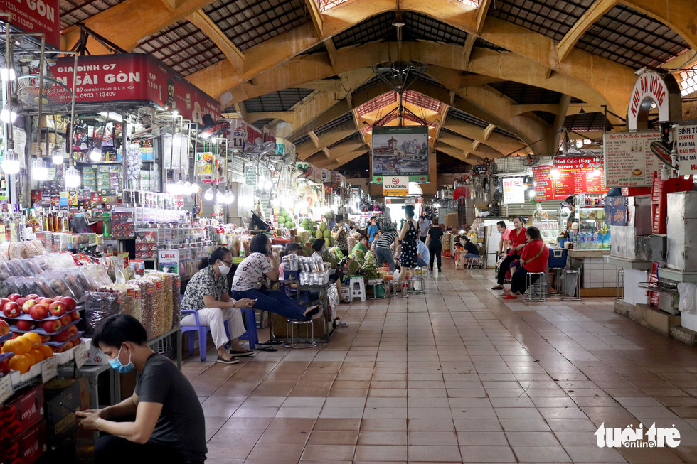 Once crowded Ben Thanh Market in Ho Chi Minh City has turned sparse these days as the market has received almost no foreign tourists, the place's major customers, for months due to COVID-19. Photo: Khanh Tran / Tuoi Tre