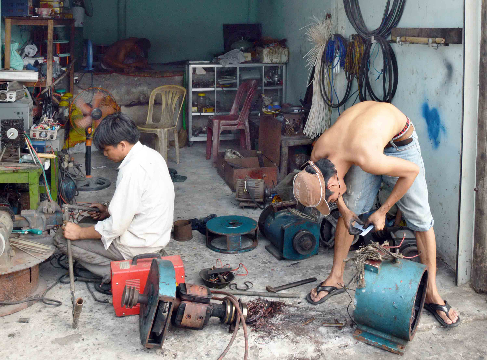 Mechanics work in a workshop on Tho Chau Islands off Kien Giang Province, Vietnam.