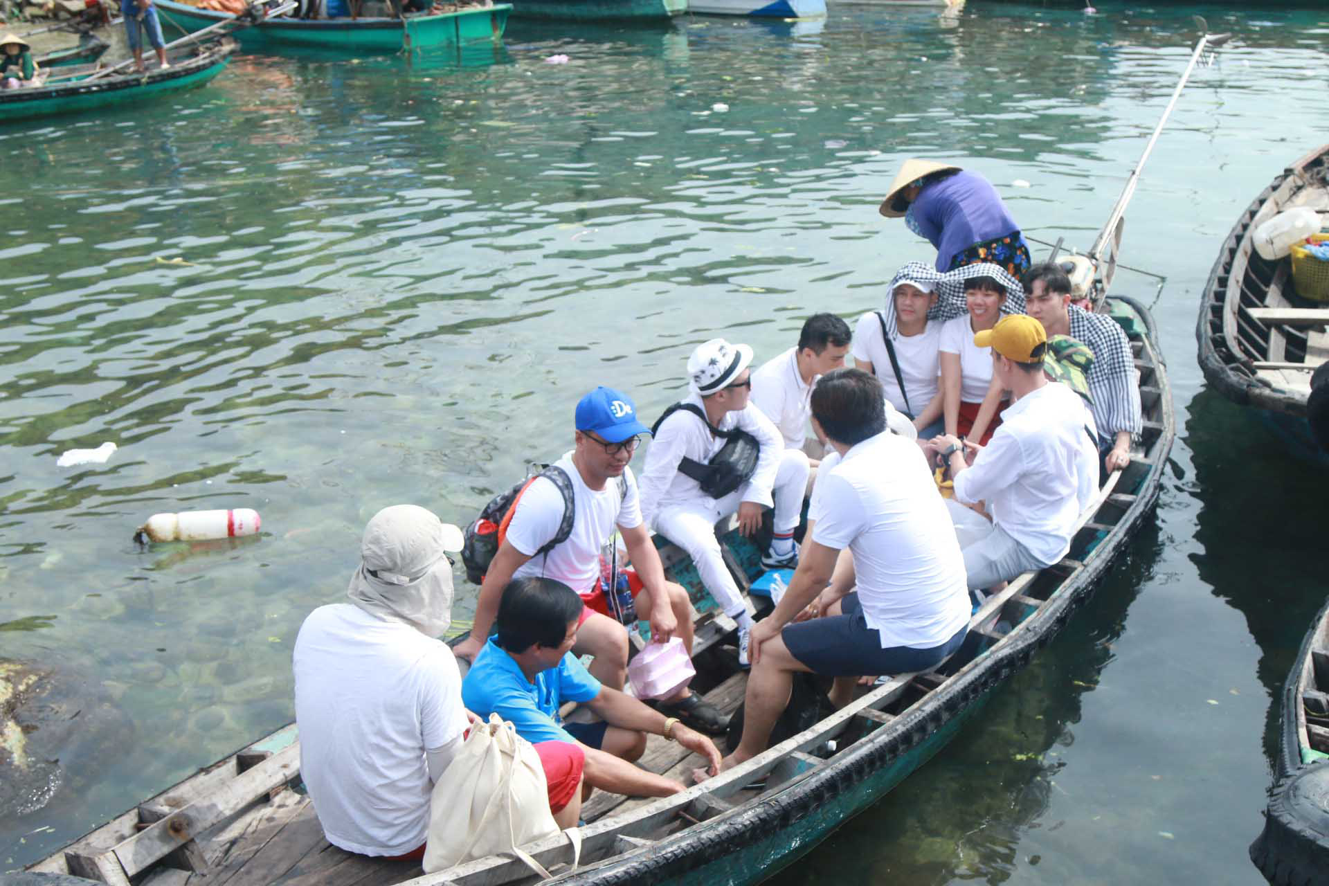 Tourists are ferried on a boat to visit fish farming rafts near Tho Chau Islands off Kien Giang Province, Vietnam.