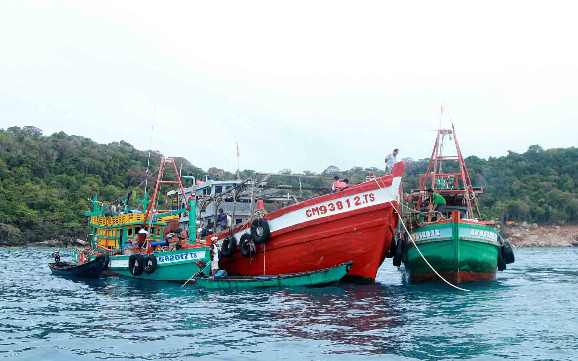 Fishing boats trade sea catch near Tho Chau Islands off Kien Giang Province, Vietnam.