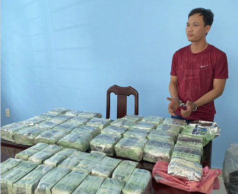 A drug ring member is held at a police station in Ho Chi Minh City in a supplied photo.