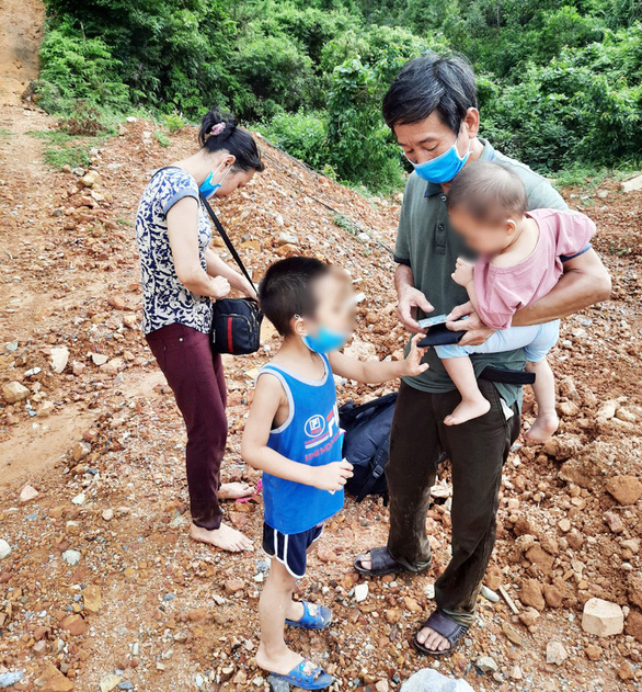 Two adults and two children arrested after swimming through a river to illegally enter Vietnam from China are pictured in Hai Ha District, Quang Ninh Province, Vietnam, June 26, 2020 in this supplied photo. Photo: Quang Ninh Information Portal