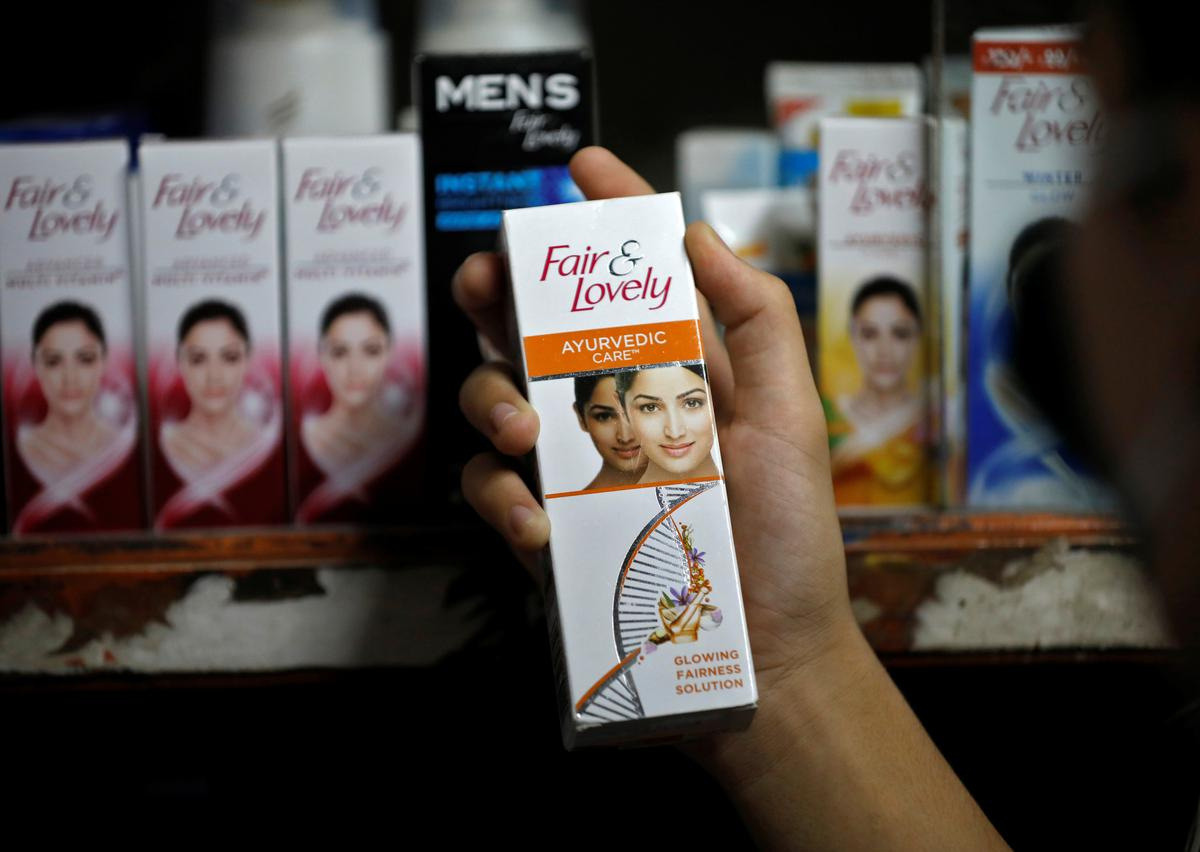 A customer picks up 'Fair & Lovely' brand of skin lightening product from a shelf in a shop in Ahmedabad, India, June 25, 2020. Photo: Reuters