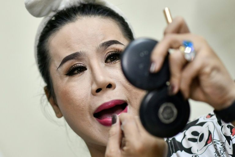 'We perform with our sweat, tears and blood,' says La Kim Quyen of the Sai Gon Tan Thoi LGBT lotto troupe in Vietnam. Photo: AFP