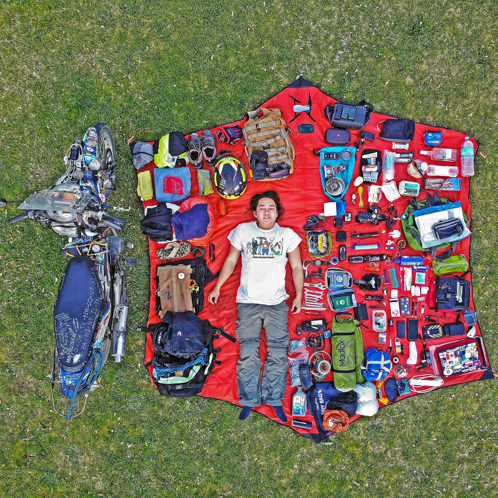 Tran Dang Dang Khoa is seen in a aerial picture he poses with the motorbike and equipment for his world trip. Photo: Supplied