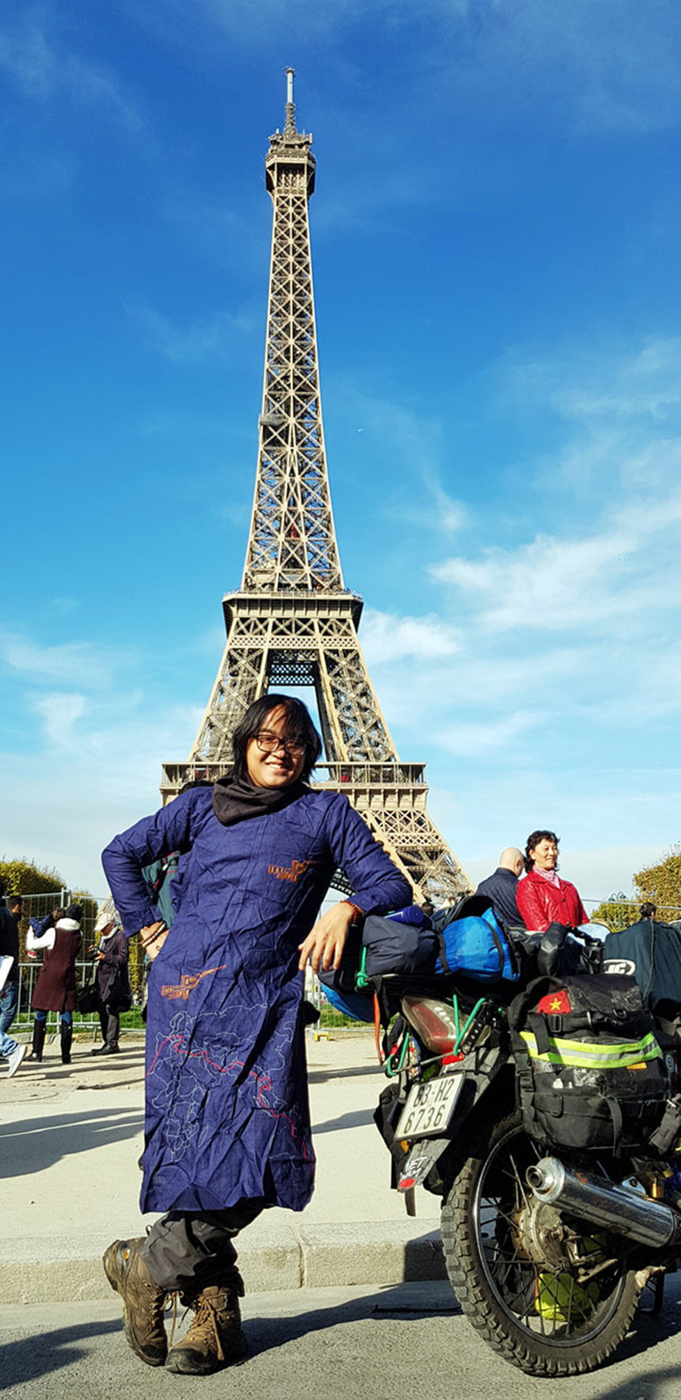Tran Dang Dang Khoa is seen in a photo capturing him in Vietnamese traditional ao dai and his beloved bike at the iconic Eiffel Tower in Paris in October 2017. Photo: Supplied