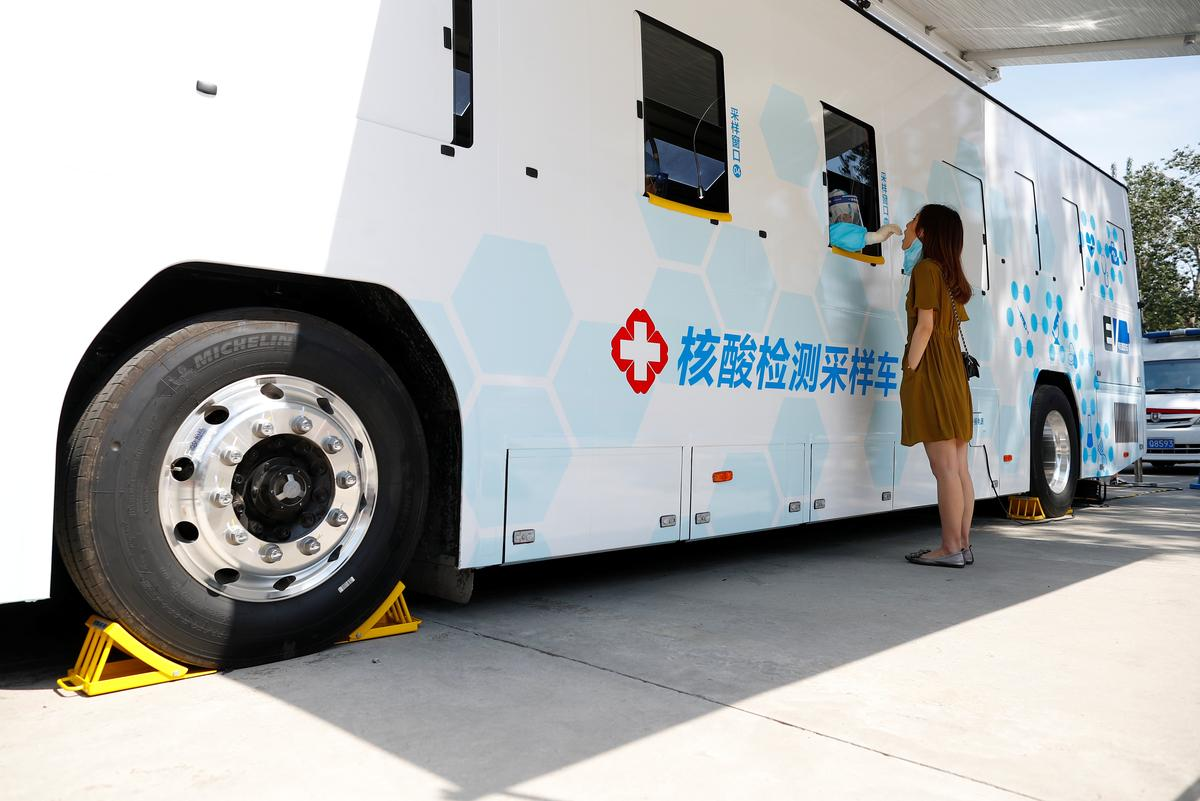 A person is tested at the window of a testing vehicle, following a new outbreak of the coronavirus disease (COVID-19) in Beijing, China, June 30, 2020. Photo: Reuters