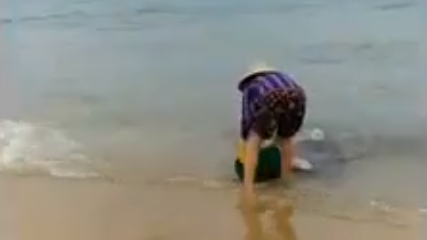 Video shows woman dumping garbage on Vietnam beach, taunting onlooker