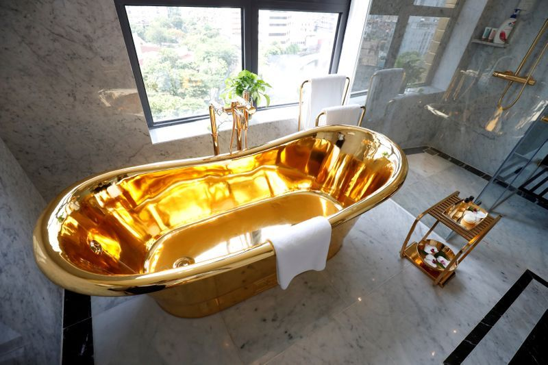 A gold-plated bathtub is seen in the newly inaugurated Dolce Hanoi Golden Lake luxury hotel, after the government eased nationwide social distancing following the global outbreak of the coronavirus disease (COVID-19), in Hanoi, Vietnam. Photo: Reuters